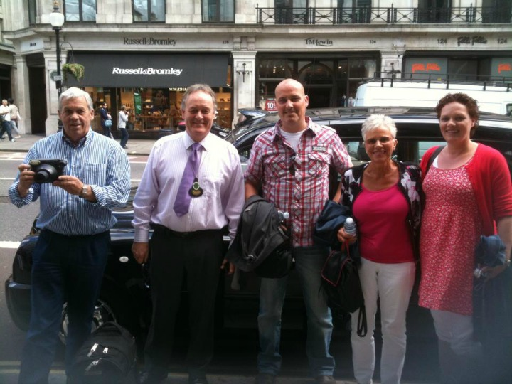 BCHT Guide (and Master of the Worshipful Company of Hackney Carriage Drivers) Jim Rainbird (2nd from left) with his happy crew after a recent Tour