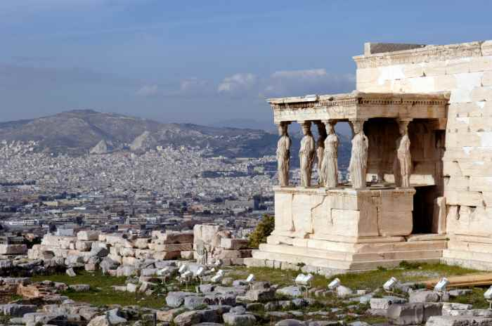 View of Athens and the Erechtheum (porch of the Caryatids) from the Acropolis.